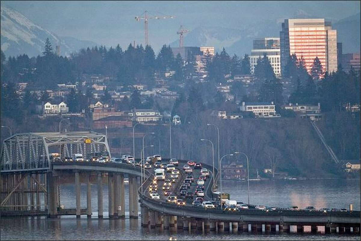Traffic crosses the 520 Bridge heading east over Lake Washington on Wednesday. A key member of the Legislature wants to impose tolls on just the 520 Bridge for the improvements to the span, arguing they shouldn't be charged on both that bridge and the I-90 bridge.