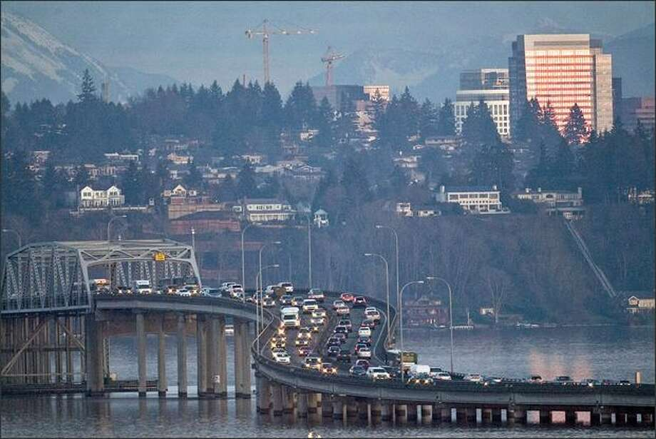 Traffic crosses the 520 Bridge heading east over Lake Washington on Wednesday. A key member of the Legislature wants to impose tolls on just the 520 Bridge for the improvements to the span, arguing they shouldn't be charged on both that bridge and the I-90 bridge. Photo: Grant M. Haller/Seattle Post-Intelligencer