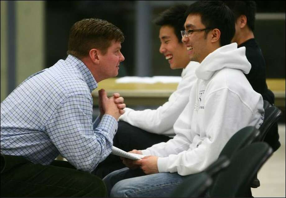 Greg Hamilton, left, owner of InSights Training Center, explores body language and personal space Wednesday with UW student Rocky Tang. Photo: Joshua Trujillo/Seattle Post-Intelligencer