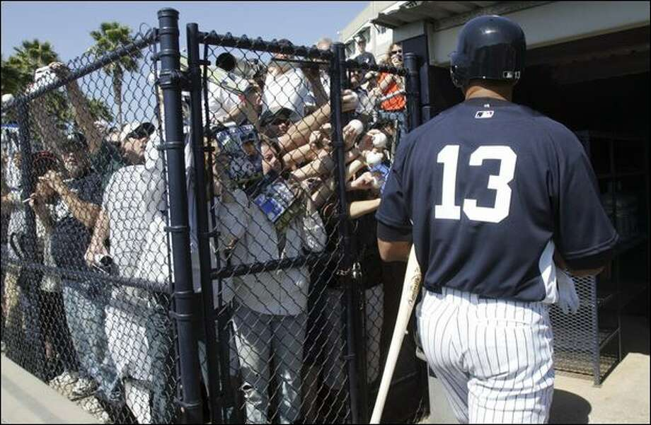 Fans at training camp Wednesday seek autographs from Yankees slugger Alex Rodriguez, who has admitted using steroids from 2001-03. Photo: Mary Altaffer/Associated Press