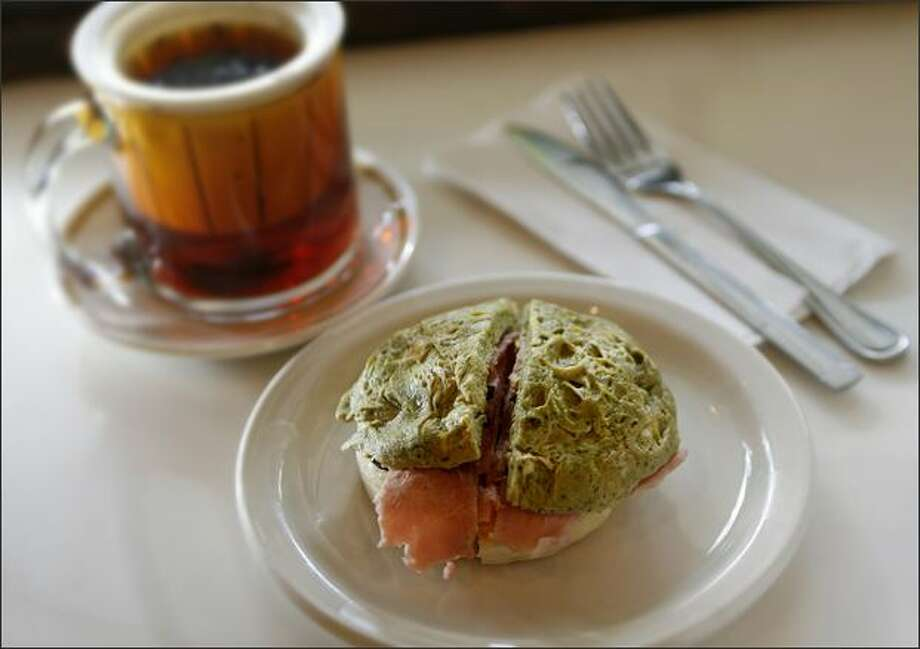 A green-eggs-and-ham topped crumpet ($4.35) paired with an Assam Superior infused black tea ($2.25) at the The Crumpet Shop, 1503 First Ave. Photo: Dan DeLong/Seattle Post-Intelligencer