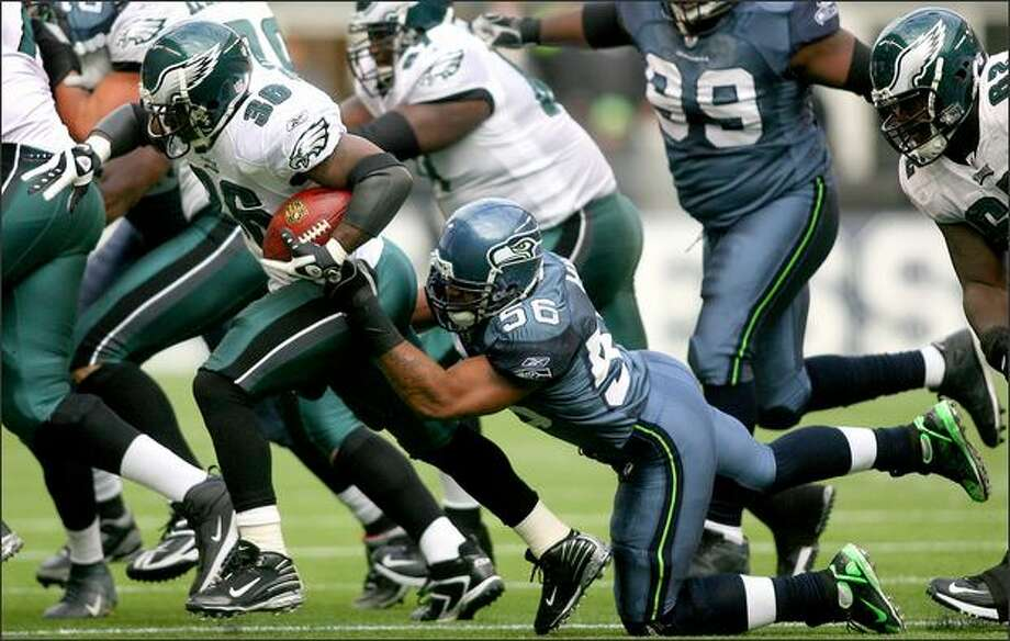 Leroy Hill was the Seahawks' third-leading tackler with 84 despite missing the last four games after suffering a stinger against Dallas on Thanksgiving Day. Hill is shown bringing down Eagles' running back Brian Westbrook in a game last November at Qwest Field. Photo: Scott Eklund/Seattle Post-Intelligencer