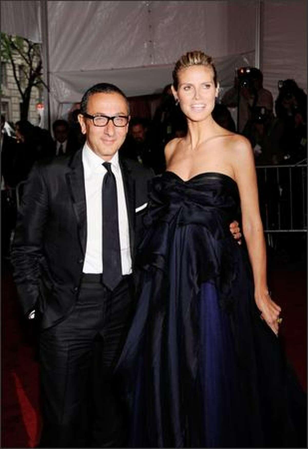 (L-R) Designer Gilles Mendel and model Heidi Klum attend