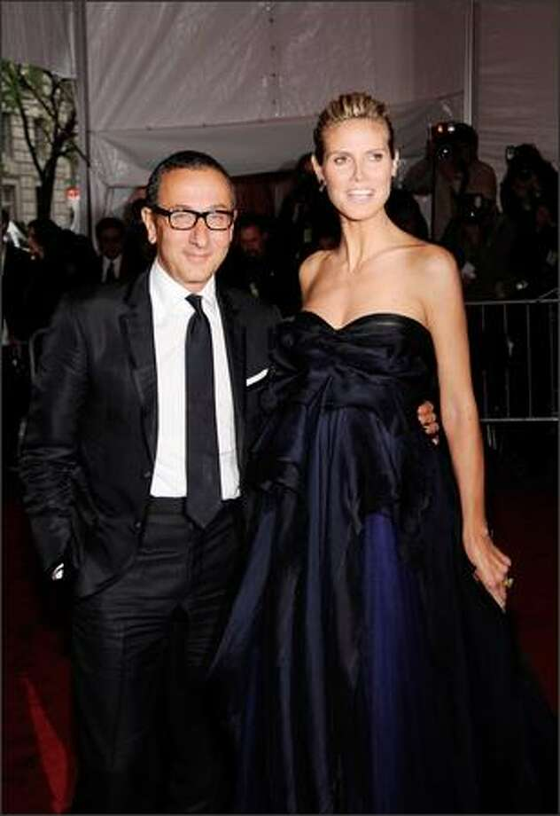 "(L-R) Designer Gilles Mendel and model Heidi Klum attend ""The Model as Muse: Embodying Fashion"" Costume Institute Gala at The Metropolitan Museum of Art in New York City. Photo: Getty Images"