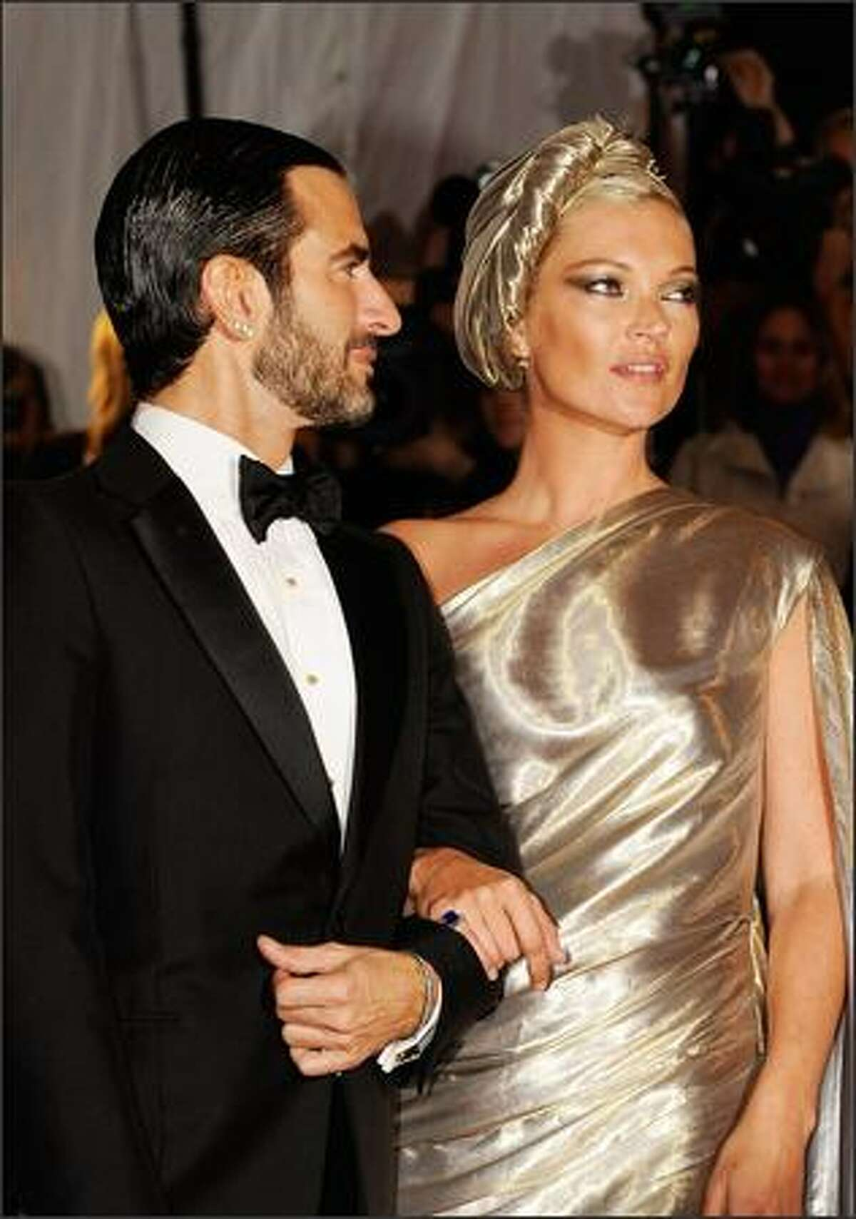 """(L-R) Model Kate Moss and designer Marc Jacobs attend """"The Model as Muse: Embodying Fashion"""" Costume Institute Gala at The Metropolitan Museum of Art in New York City."""
