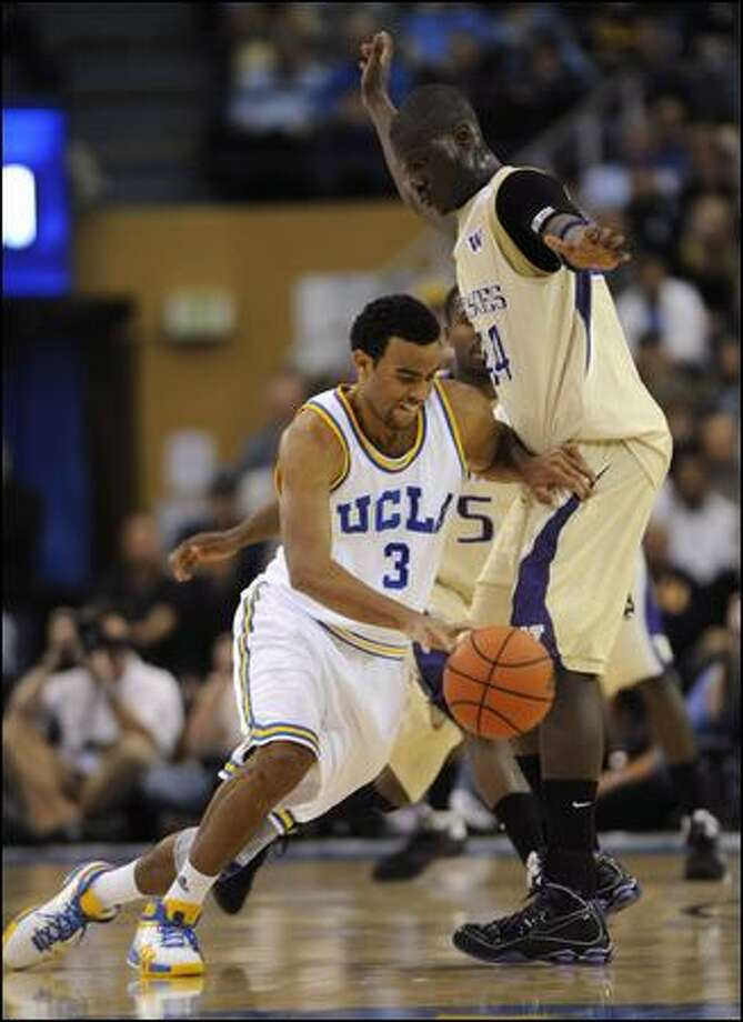 UCLA's Josh Shipp drives past the Huskies' Darnell Gant in the first half. Shipp led the Bruins with 20 points; in the teams' first meeting -- an 86-75 victory by Washington in Seattle last month -- he scored 25. Photo: Phil Mccarten/Associated Press
