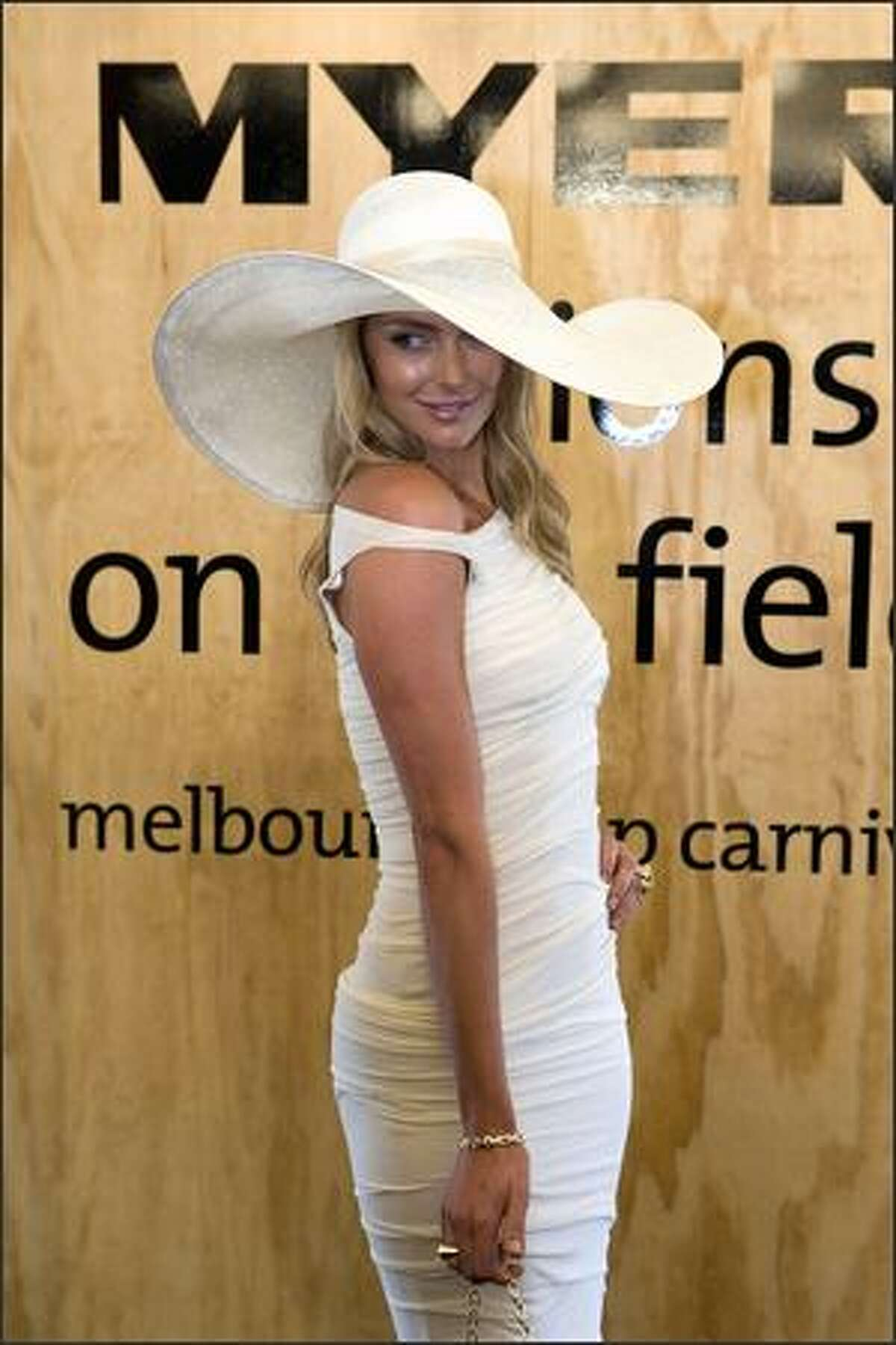Model/TV personality Jennifer Hawkins attends the AAMI Victoria Derby Day at Flemington Race Course in Melbourne, Australia, on Saturday. Derby Day, like its counterpart at Ascot Race Course in England, is the social event of the thoroughbred horse racing season.