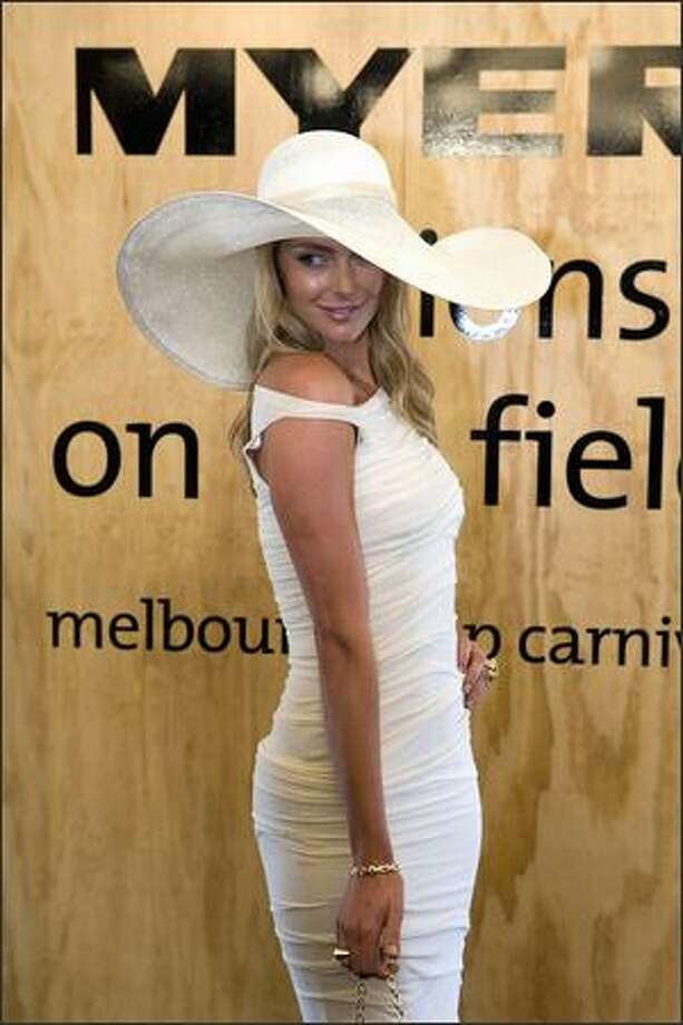 Model/TV personality Jennifer Hawkins attends the AAMI Victoria Derby Day at Flemington Race Course in Melbourne, Australia, on Saturday. Derby Day, like its counterpart at Ascot Race Course in England, is the social event of the thoroughbred horse racing season. Photo: Getty Images