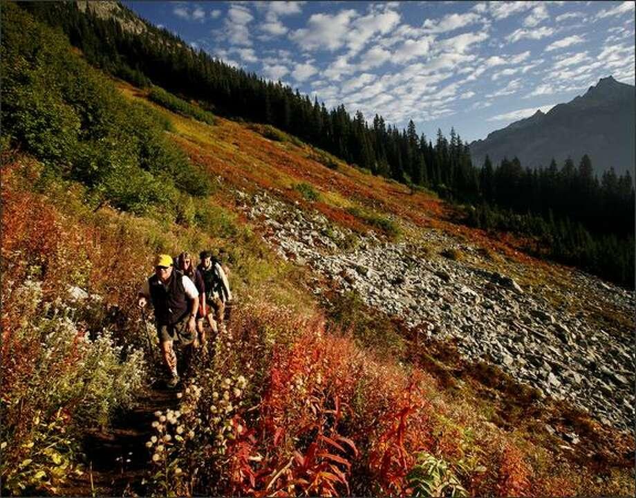 Hikers ascend toward Maple Pass on Sept. 30, 2008. (Paul Joseph Brown/Seattle P-I) Photo: P-I File