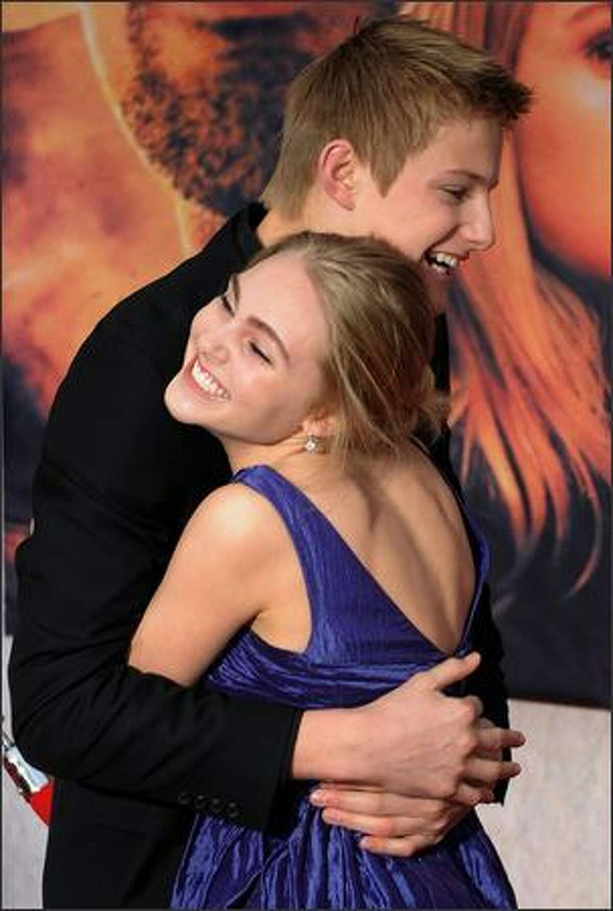 """Actor Alexander Ludwig hugs co-star AnnaSophia Robb as they arrive for the world premiere of the Disney film """"Race to Witch Mountain"""" at the El Capitan theatre in Los Angeles. Ludwig plays the role of """"Seth"""" and AnnaSophia as """"Sara"""" in the film about two teenagers who team up with a Las Vegas taxi driver to save the world by unravelling the secrets of Witch Mountain."""