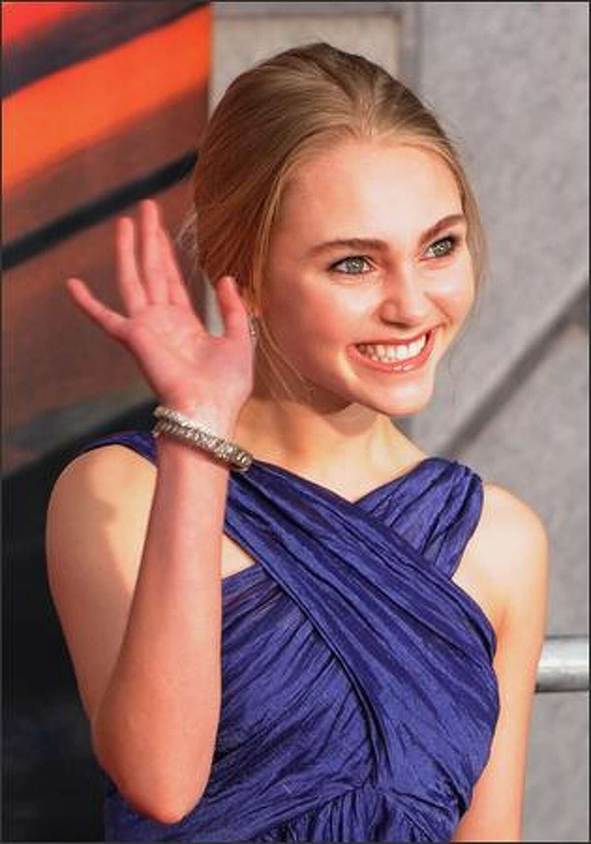 Actor AnnaSophia Robb pose for photos as she arrives for the world premiere of the Disney film