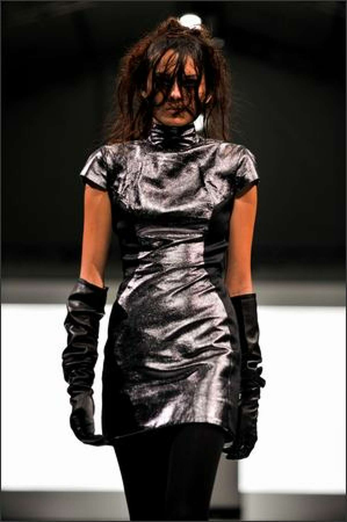 A model walks the runway wearing designs by Gareth Pugh on the closing catwalk at the Ngee Ann City Civic Plaza on day two of Audi Fashion Festival Singapore in Singapore on Thursday, May 7, 2009.