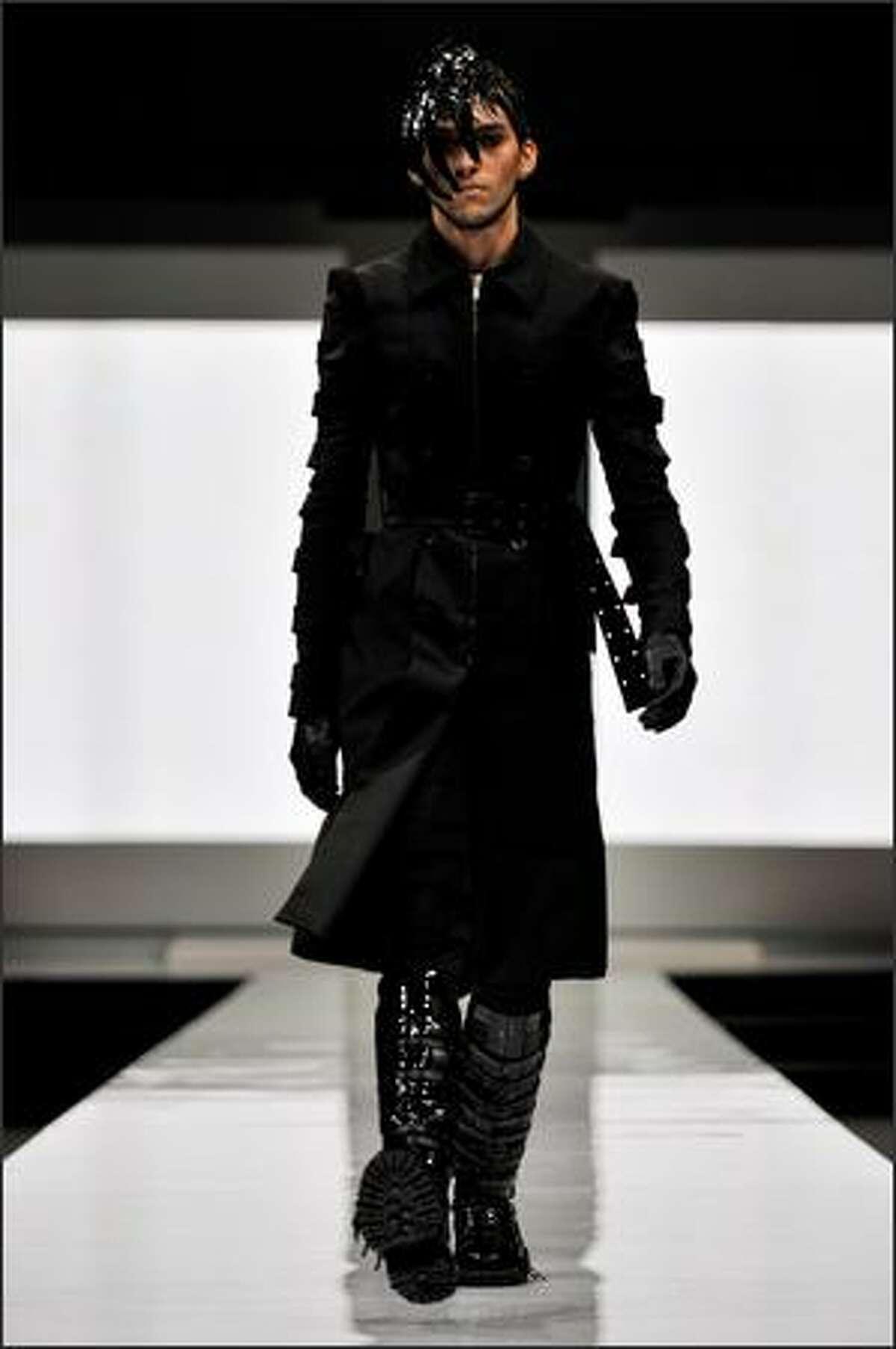 A model walks the runway wearing designs by Gareth Pugh.