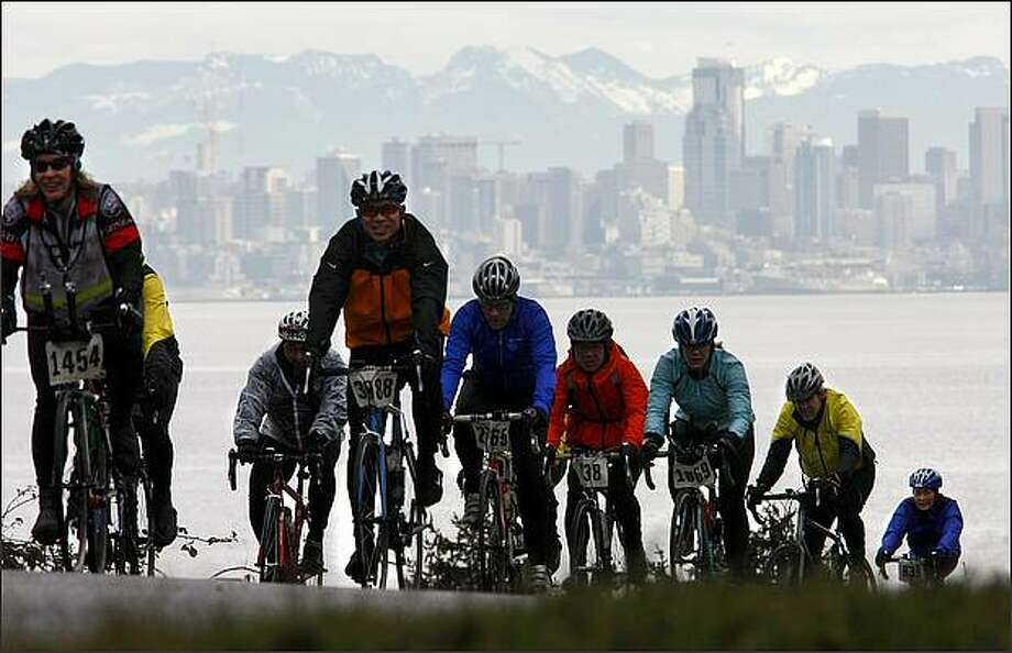 With the Seattle skyline behind them, riders head toward the finish of the Chilly Hilly bicycle ride on Bainbridge Island on Sunday. Photo: Andy Rogers/Seattle Post-Intelligencer