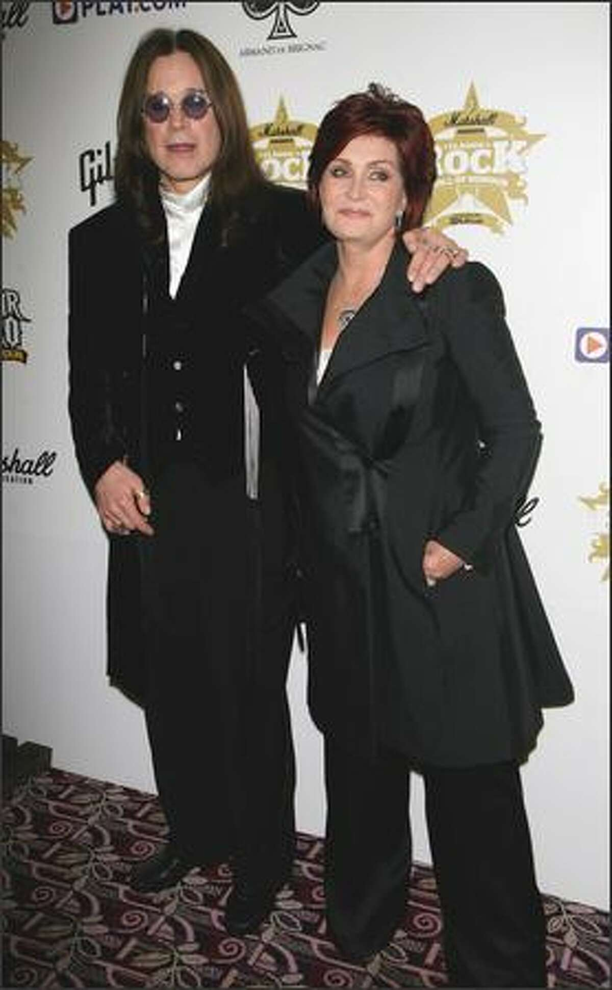 Ozzy Osbourne and Sharon Osbourne arrive for the Classic Rock Roll of Honour at the Park Lane Hotel on Monday in London.