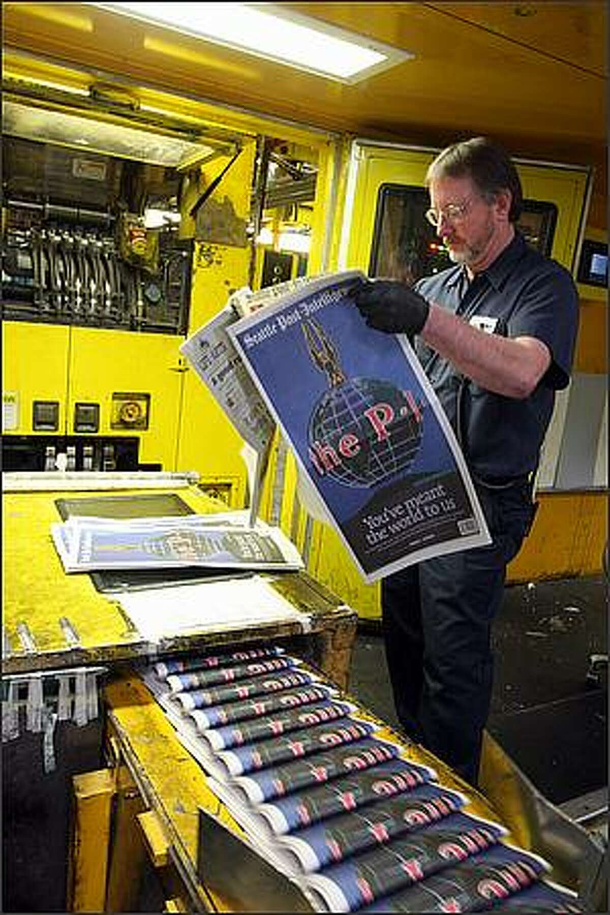 Press operator James Herron checks folios, cut offs, and color of the final edition of the Seattle Post-Intelligencer at the Seattle Times North Creek facility in Bothell, Washington on March 16, 2009. The Seattle Post Intelligencer has been publishing since 1863.