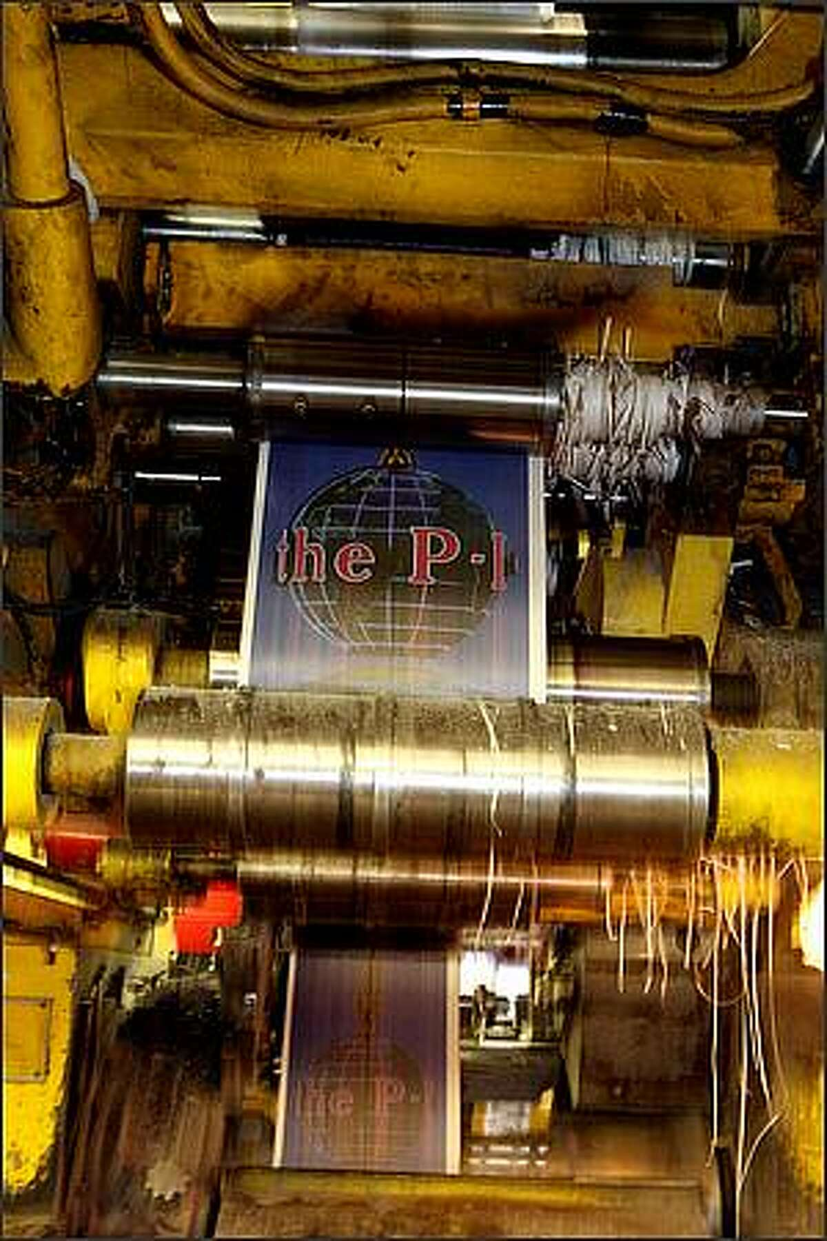 Printing presses print the final edition of the Seattle Post-Intelligencer at the Seattle Times North Creek facility in Bothell, Washington on March 16, 2009. The Seattle Post Intelligencer has been publishing since 1863.