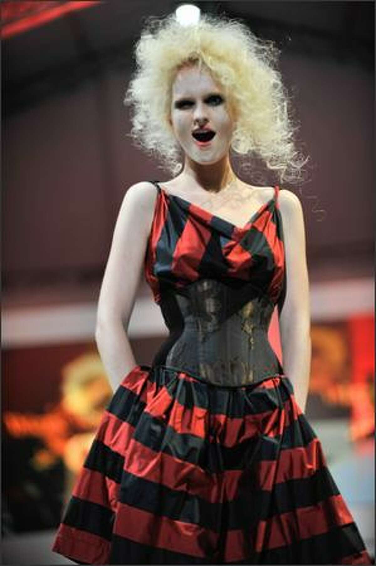A model showcases designs by Vivienne Westwood for her Autumn/Winter 2009 collection on the catwalk at the Ngee Ann City Civic Plaza on Day 5 - and the last day - of the Audi Fashion Festival Singapore on Sunday in Singapore.
