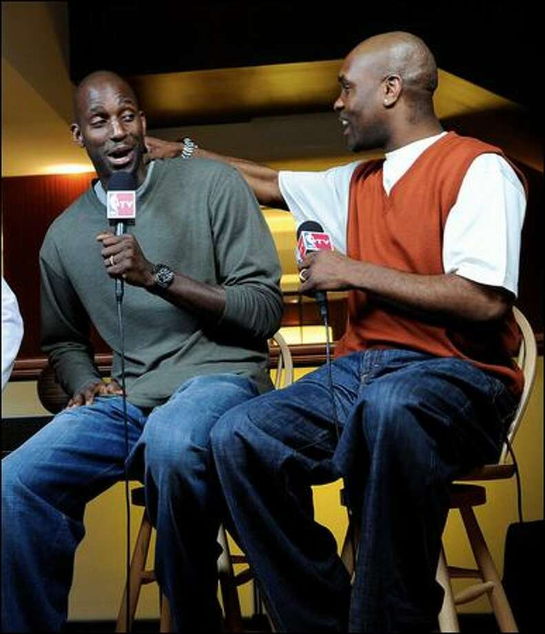 Gary Payton, right, banters with Celtics star Kevin Garnett during NBA TV coverage of All-Star weekend festivities in Phoenix. Photo: Getty Images