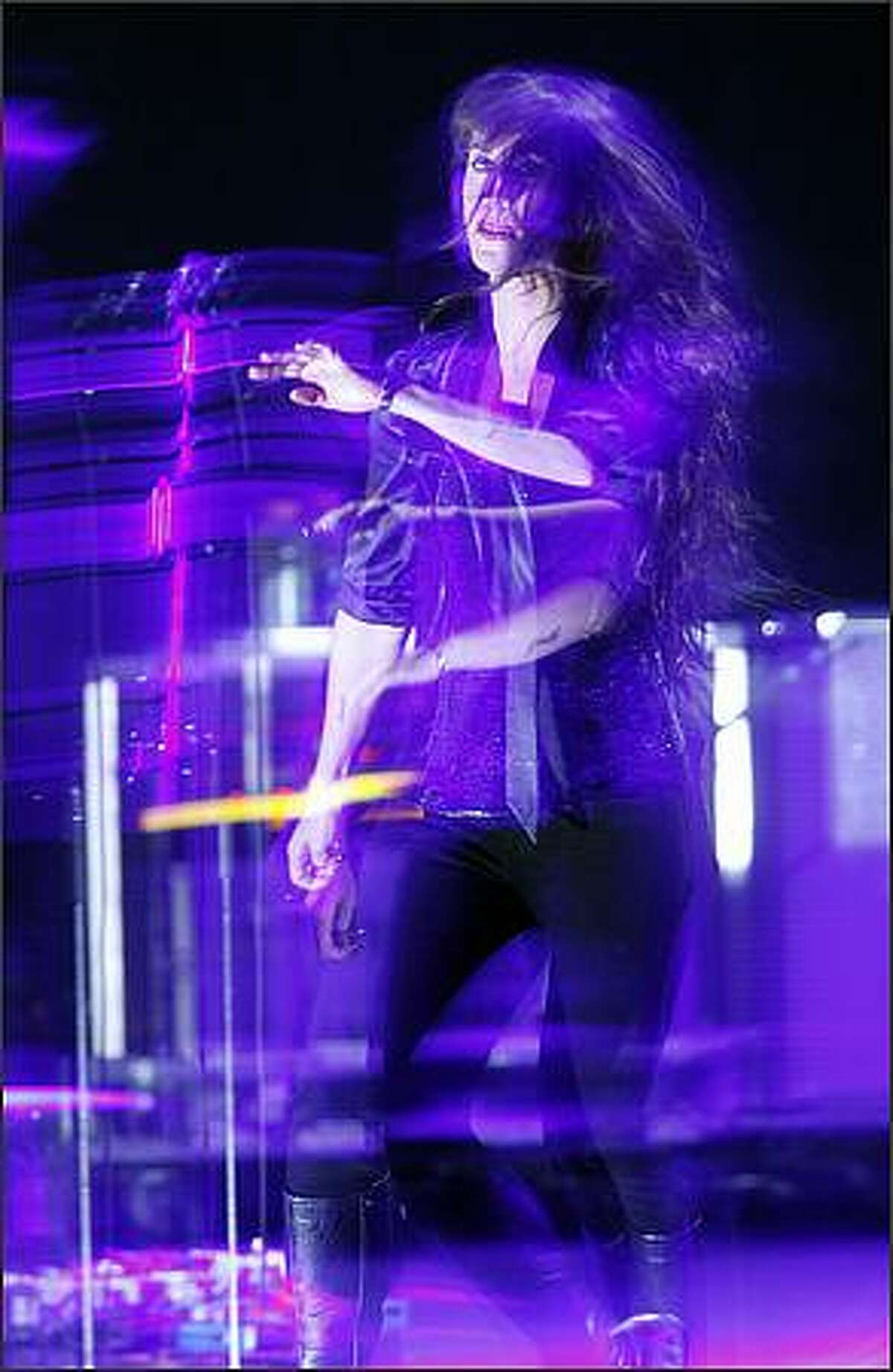 Illuminated by strobe lights and captured by a slow shutter speed Alanis Morissette plays the Paramount Theater.