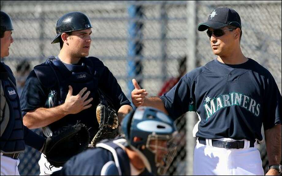 Mariners manager Don Wakamatsu instructs catcher Jeff Clement, whose work with pitchers includes a big role in maintaining a quick tempo of play. Wakamatsu is stressing a faster tempo in games at spring training in Arizona. Photo: Scott Eklund/Seattle Post-Intelligencer