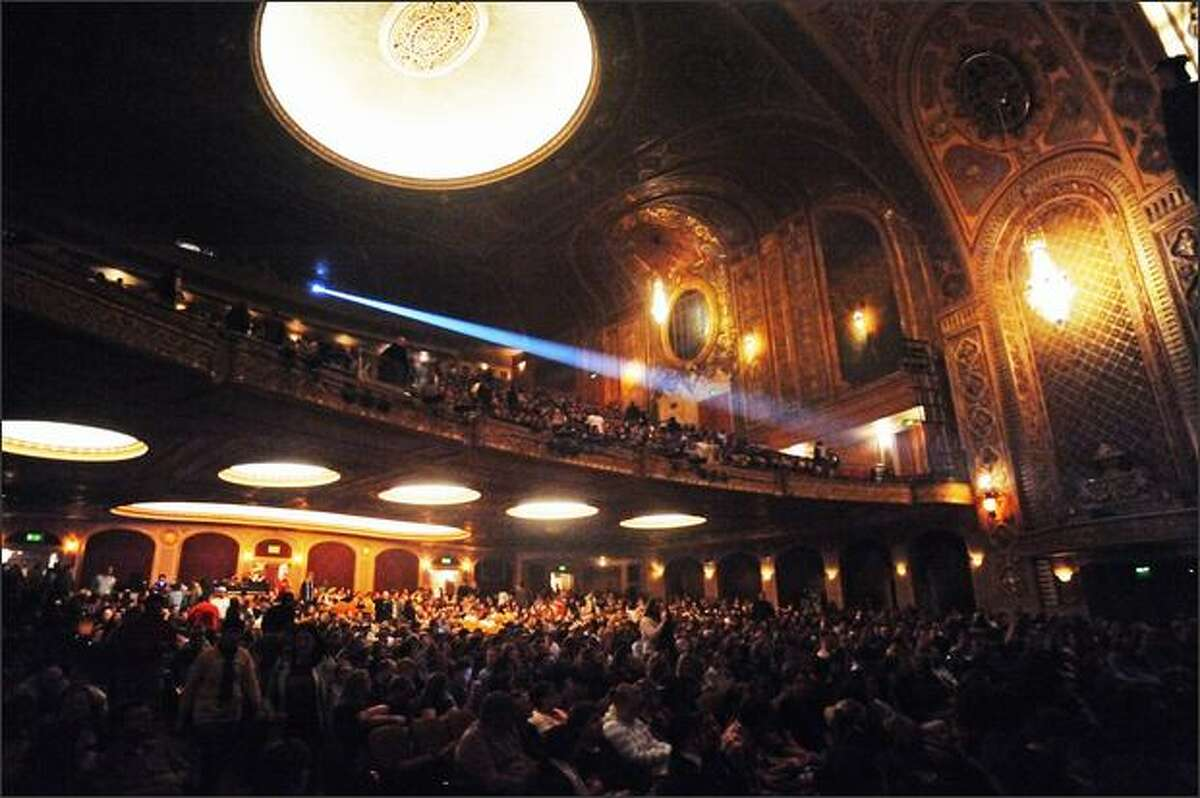 Fans begin seating inside the Paramount Theatre for the Flight of the Conchords concert.