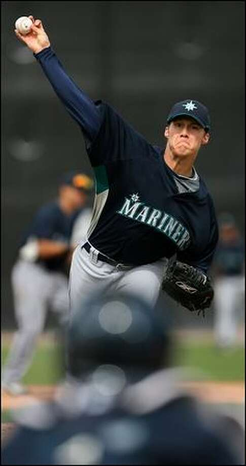 Stephen Kahn fires a pitch during the Mariners' intrasquad game Monday. Kahn, the Mariners' fifth-round draft pick in 2005, has missed the past two seasons because of knee injuries. Photo: Scott Eklund/Seattle Post-Intelligencer