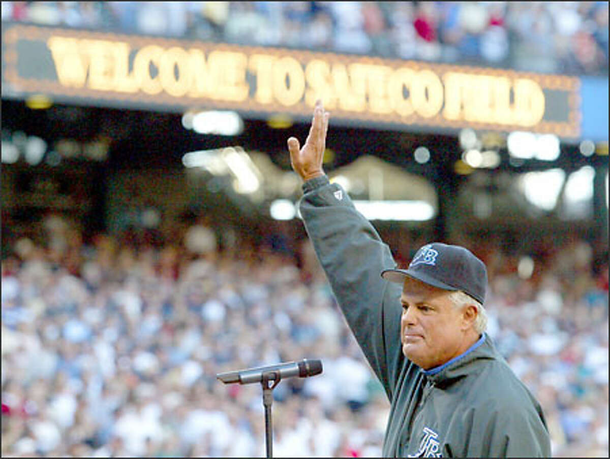 Tampa Bay Devil Rays manager Lou Piniella waves to the crowd at Safeco Field during his introduction at home plate before his new team played his old.