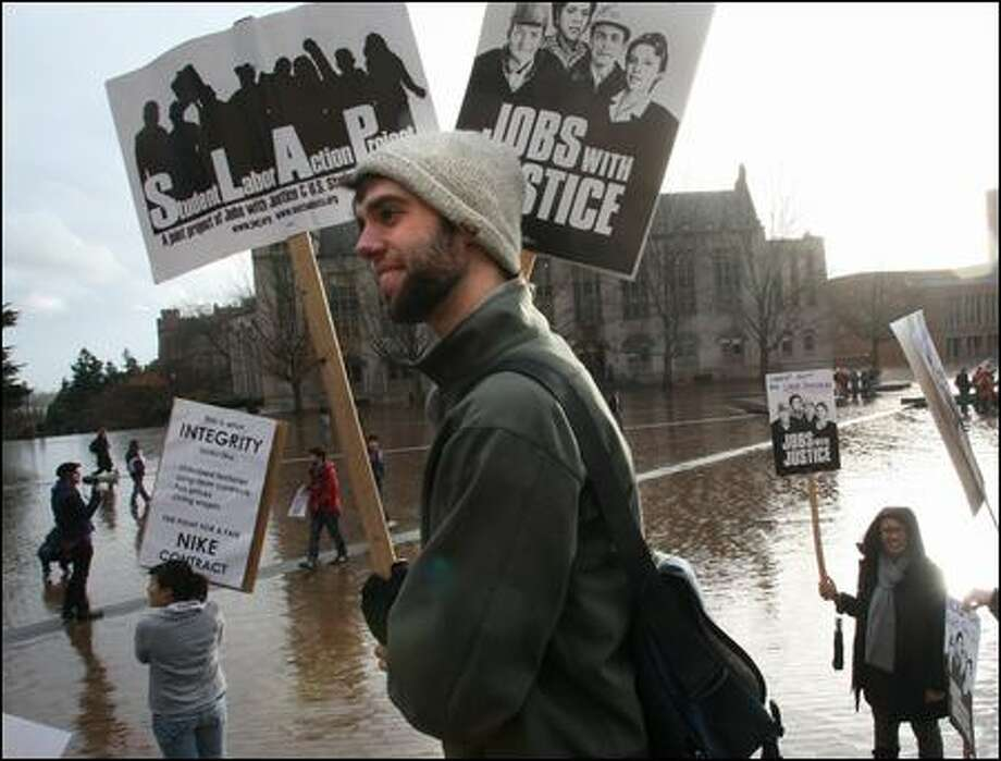 In November, UW student Travis Thomas joined the Student Labor Action Project and other coalitions to urge the university to toughen its stance on international workers' rights. Photo: Karen Ducey/Seattle Post-intelligencer/2008