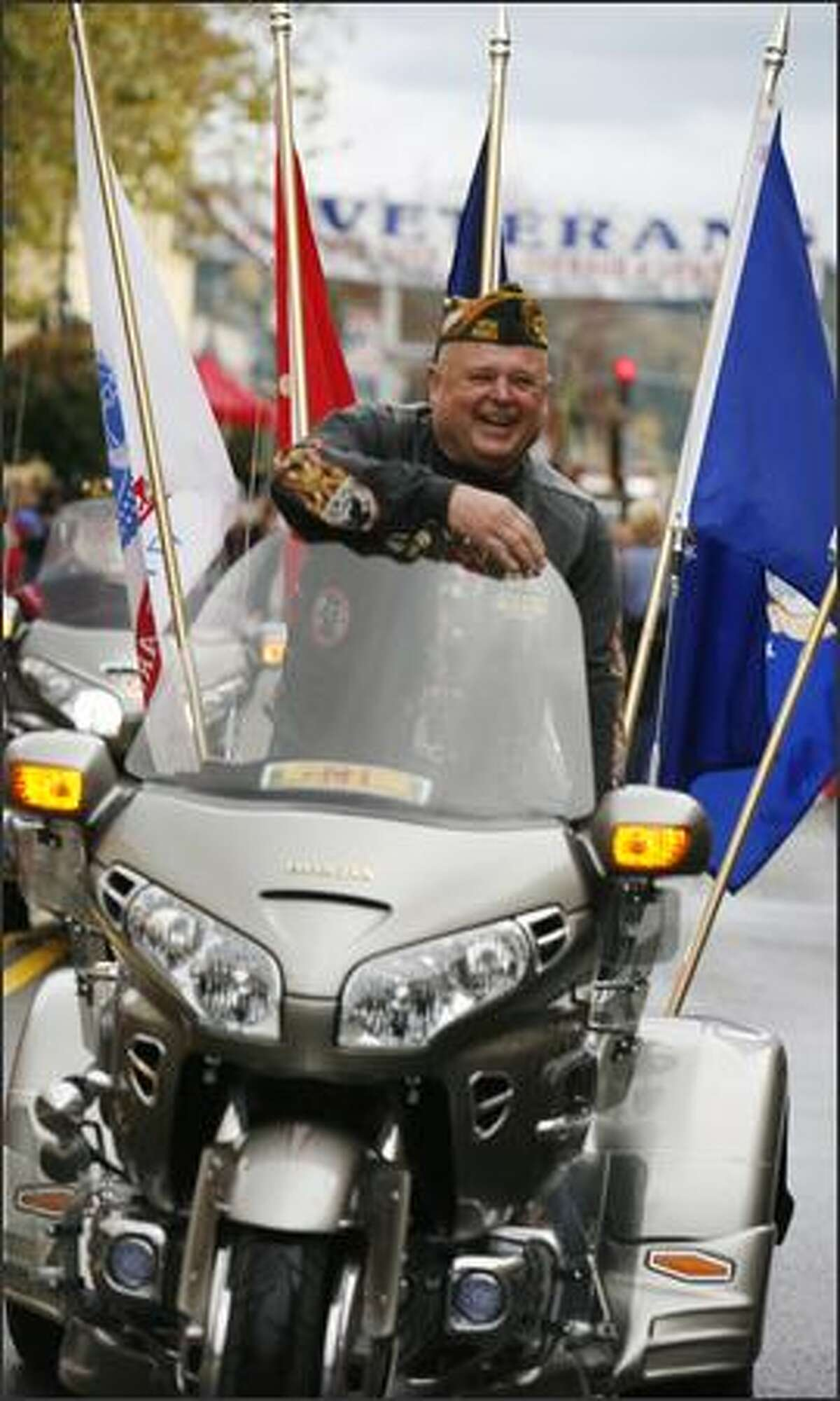 Vietnam veteran Andy Anderson, 66, rides his Honda Gold Wing Trident in the Auburn Veterans Day Parade.
