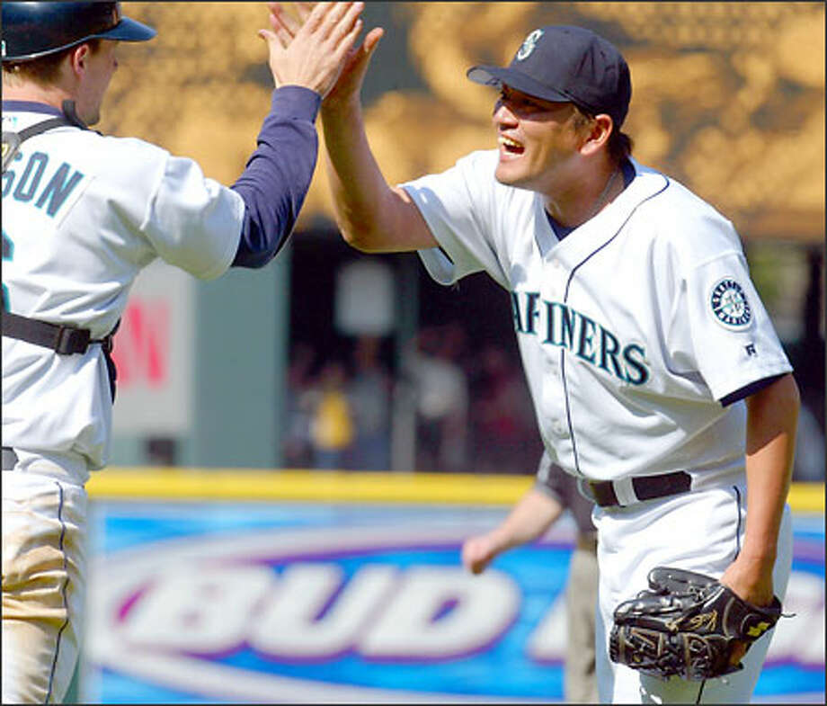Mariners closer Kazuhiro Sasaki celebrates with catcher Dan Wilson after a victory over the White Sox at Safeco Field. Photo: Karen Ducey, Seattle Post-Intelligencer