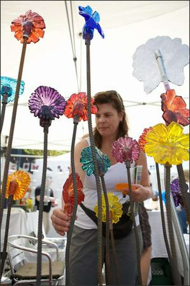 Sharon Pohlman of Seattle looks into buying a lawn ornament for her mom. Photo: Rob Watters, Special To Seattlepi.com