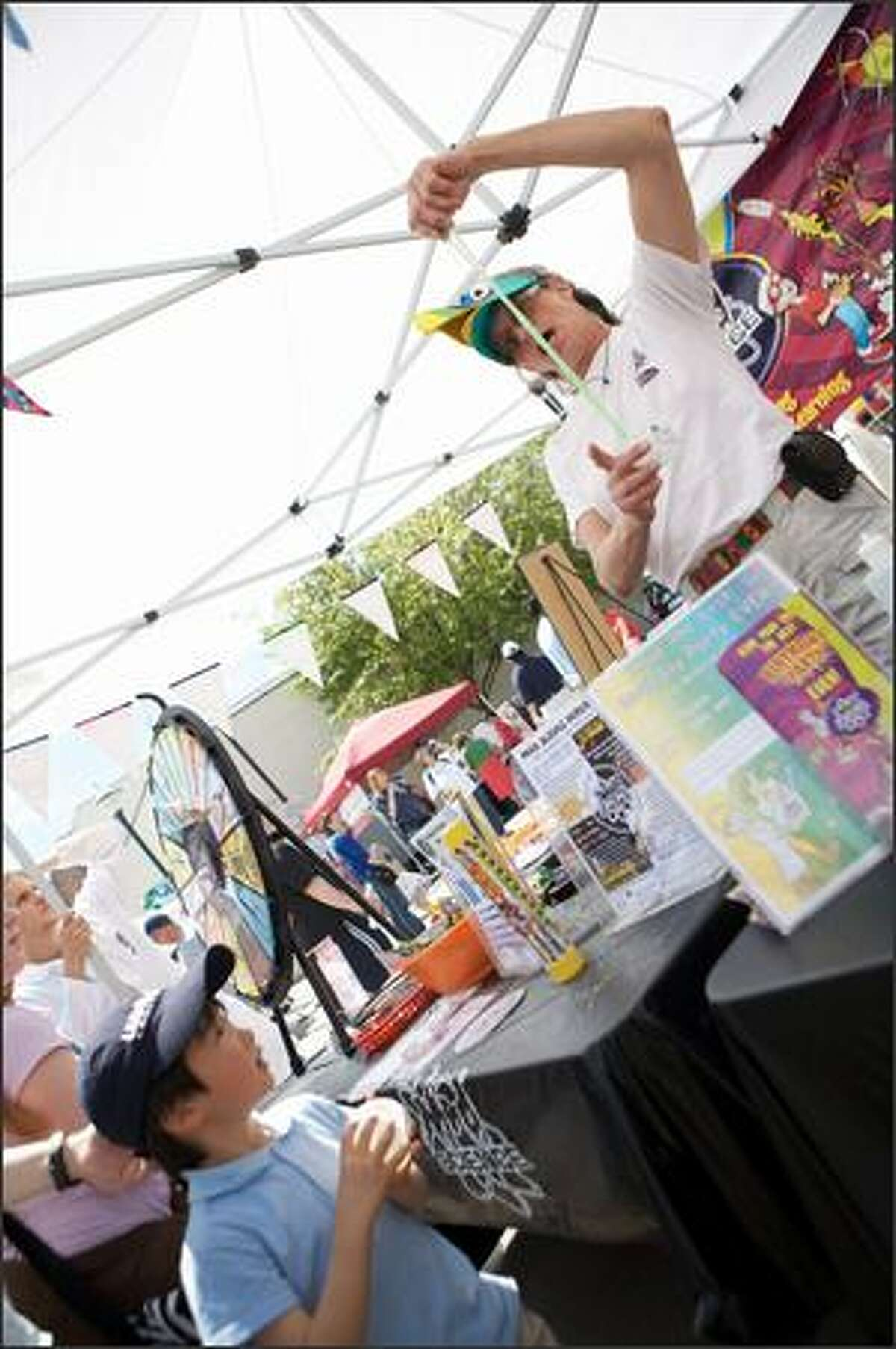 Ethan Matsubayashi of Seattle looks on at a demonstration at the Mad Science booth.
