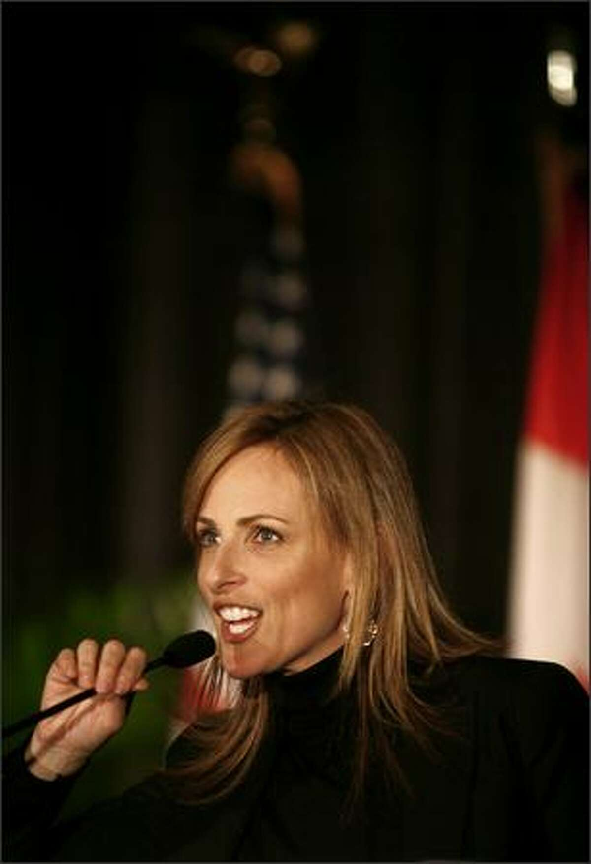 Actress Marlee Matlin speaks into the microphone during the keynote speech.
