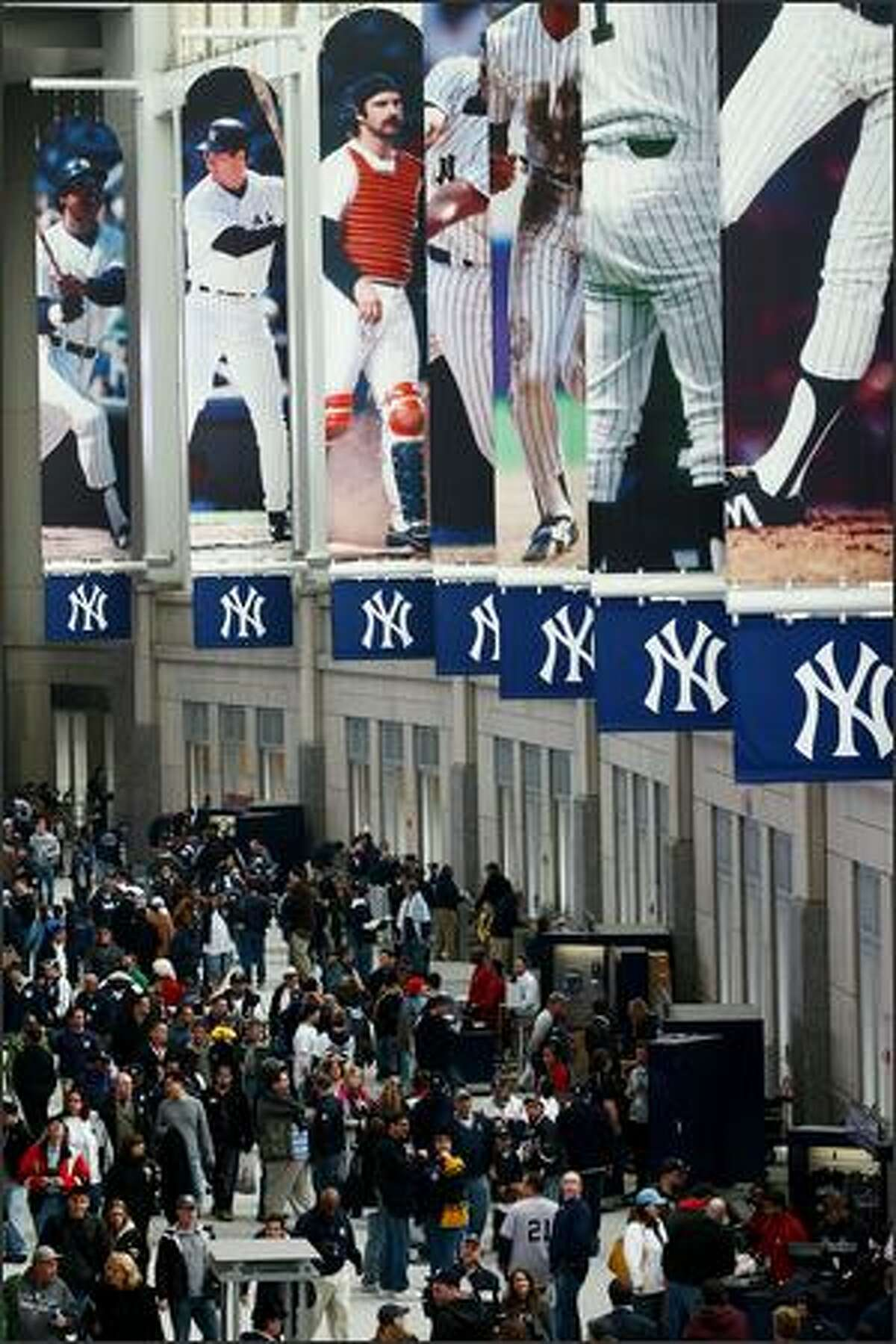 Fans enjoy the new Yankee Stadium concourse area prior to the start of the game.