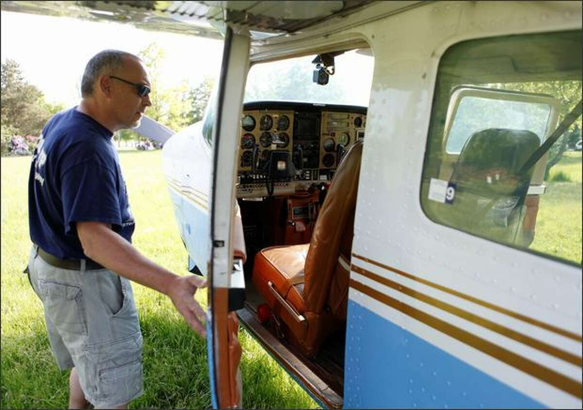 The pilot of the single-engine Cessna that landed Monday at Genesee Park closes its door.