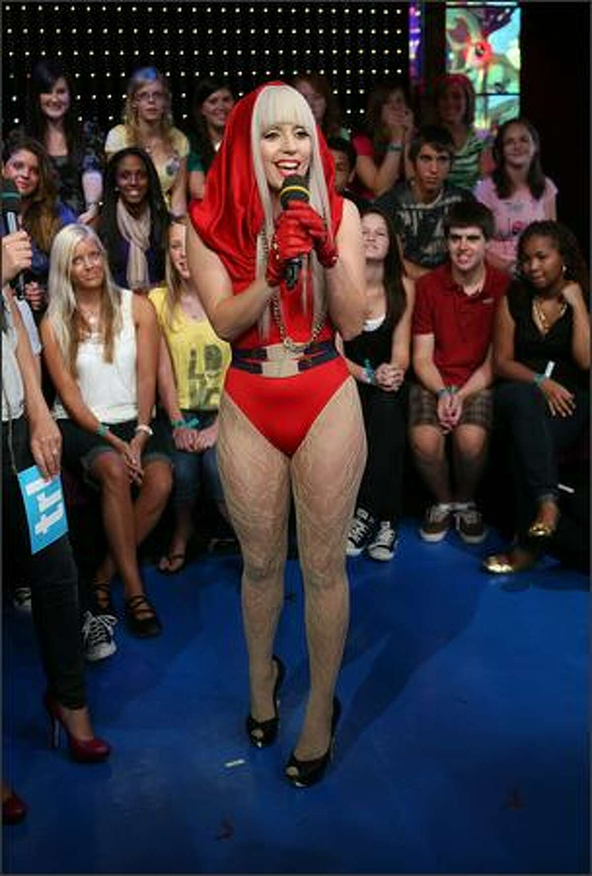 Lady Gaga appears onstage during MTV's Total Request Live at the MTV Times Square Studios August 12, 2008 in New York City.