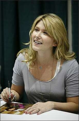 "Jewel Staite, an actress who was on ""Stargate: Atlantis"" and ""Firefly,"" signs autographs at the Emerald City ComiCon. Photo: Joshua Trujillo, Seattlepi.com"