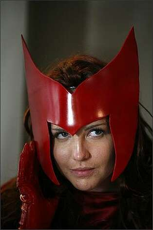 Tasli Shaw of Vancouver, B.C., shows her Scarlet Witch costume. Photo: Joshua Trujillo, Seattlepi.com