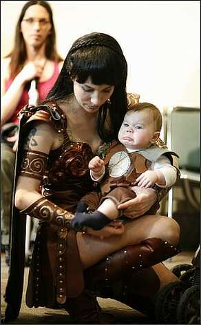Karissa Rangel -- dressed as TV's Xena, Warrior Princess -- comforts her son Daniel, dressed as occasional ally Joxer. Photo: Joshua Trujillo, Seattlepi.com