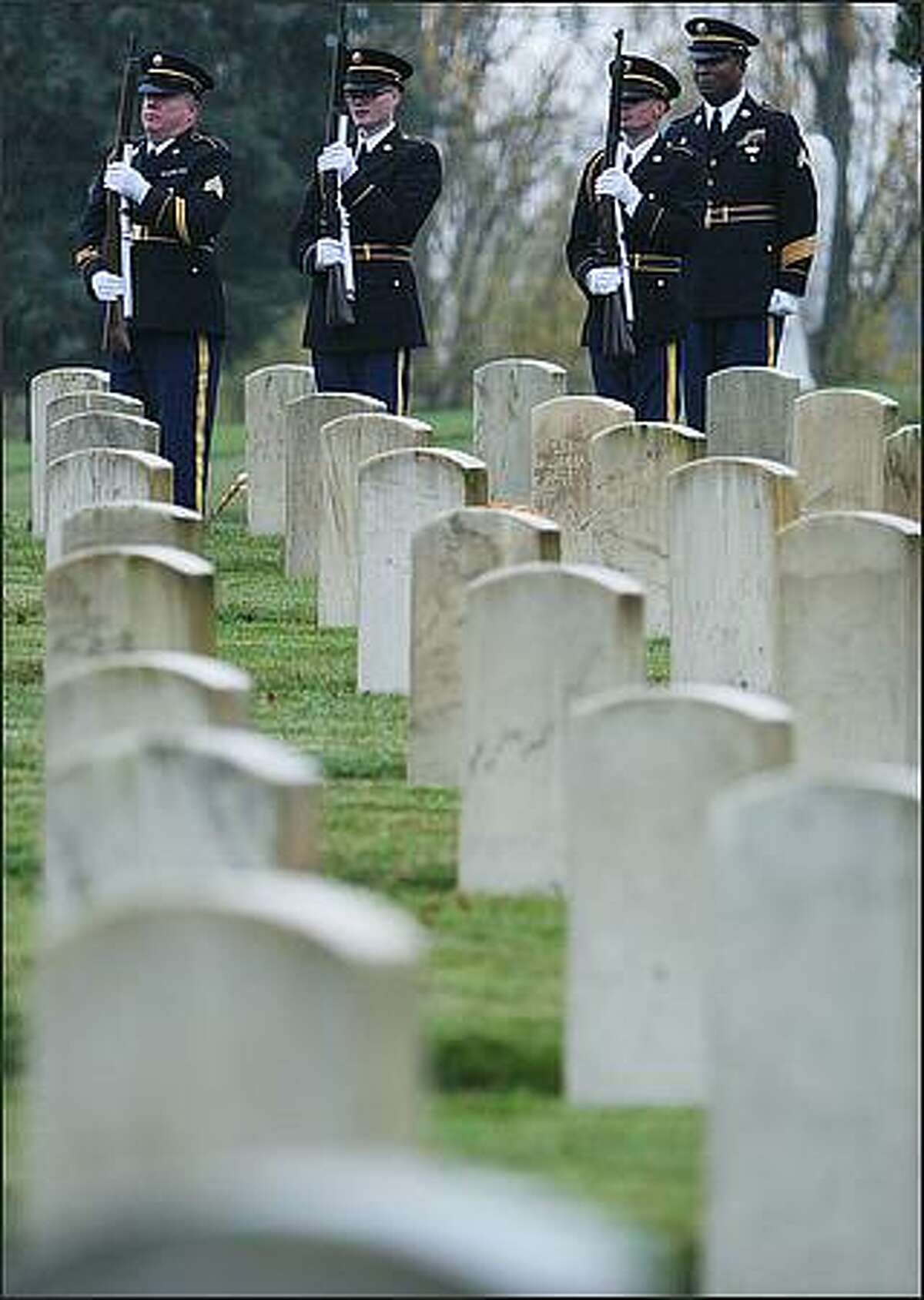 The 21-gun salute by the Washington State National Guard finishes during the 59th Annual Veterans Day of Remembrance.