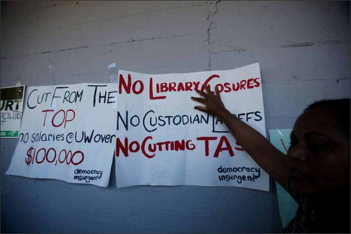 Signs are taped to the side of the Northlake Building during a rally against budget cuts and custodial swing shift eliminations at the University of Washington in Seattle, Wash. (May 28, 2009)