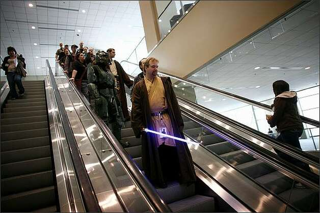Obi-Wan Kenobi, aka Dan Kroon, rides an escalator in the Washington State Convention & Trade Center. Photo: Joshua Trujillo, Seattlepi.com