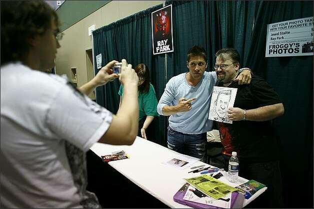 Steve Dorris of Portland has his picture taken with actor Ray Park, who played Darth Maul in Star Wars: Episode I - The Phantom Menace. Photo: Joshua Trujillo, Seattlepi.com