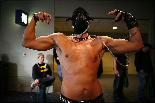 Bryan Burnley, dressed as Bane from the Batman series, shows off his lack of costume at the Emerald City ComiCon. Photo: Joshua Trujillo, Seattlepi.com