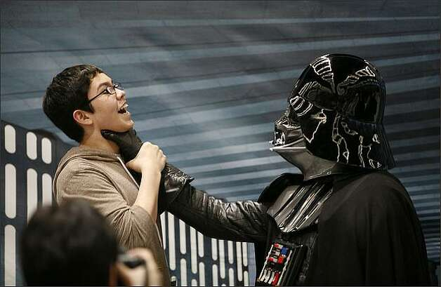 "Kevin Neblina, 14 of Everett, is ""choked"" by Darth Vader, aka Marc Semenchule. Photo: Joshua Trujillo, Seattlepi.com"