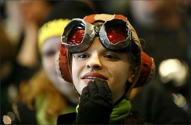 Robin Crew of Sammamish, dressed as Razputin from the Psychonauts, watches the costume competition. Photo: Joshua Trujillo, Seattlepi.com