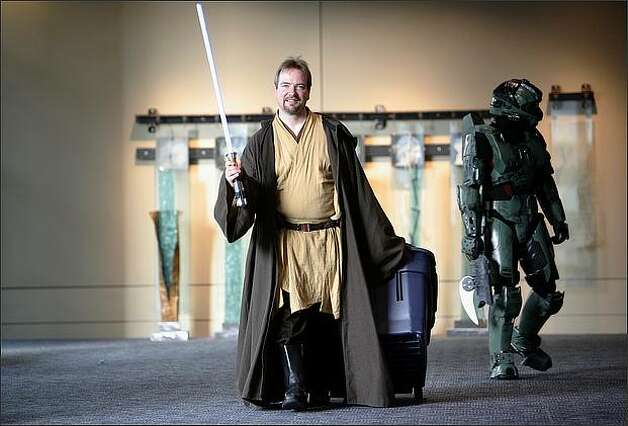 Obi-Wan Kenobi, aka Dan Kroon of Portland, and Halo's Master Chief, aka Martin Vavra, walk through the halls of the Emerald City ComiCon at the Washington State Convention & Trade Center in Seattle. Photo: Joshua Trujillo, Seattlepi.com