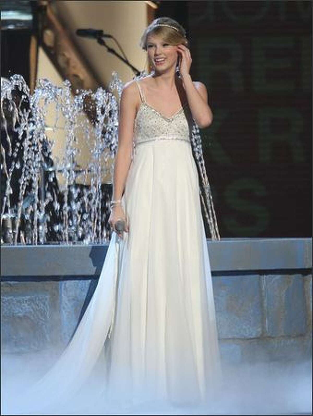 Singer Taylor Swift performs on stage.