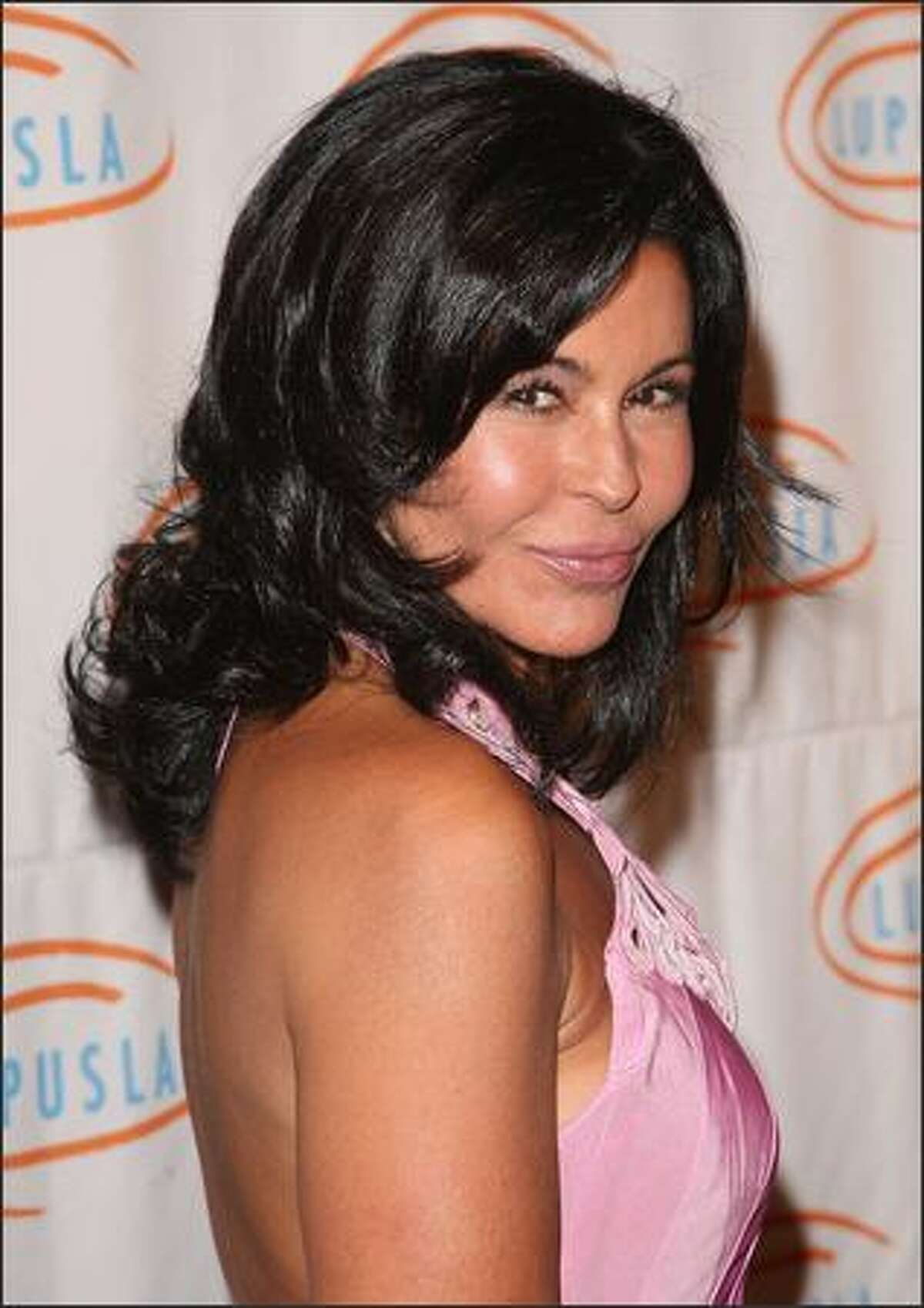 Actress Maria Conchita Alonso attends the 9th annual Lupus LA Orange Ball at the Beverly Wilshire Four Seasons Hotel in Beverly Hills, California.